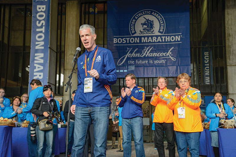 Tom Grilk, '72, addresses runners and supporters at the 2014 Boston Marathon.