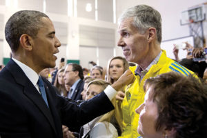 Then President Barack Obama offers encouragement to Grilk and BAA staff in the wake of the 2013 Boston Marathon bombing.