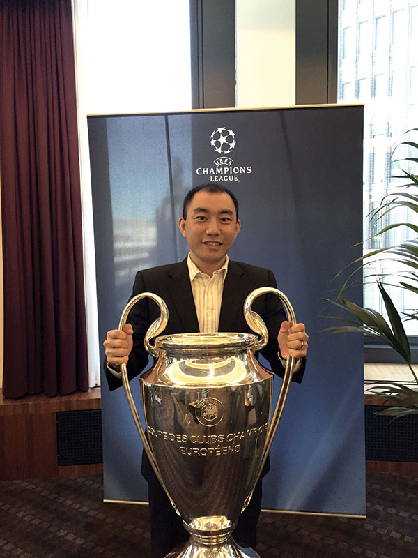 Li poses with the Union of European Football Associations' championship trophy.